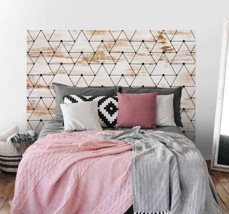 TenVinilo. Vinilo cabecero Triángulos geométricos. Cabecero adhesivo de estilo industrial con el diseño de unos triángulos sobre un fondo con textura madera. Compra Online Segura y Garantizada.