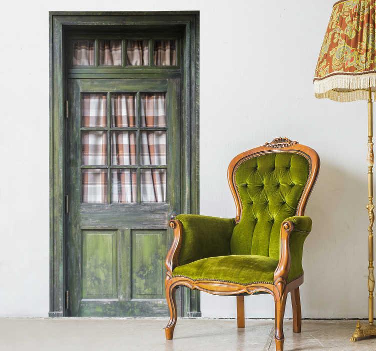 TenStickers. Fototapeta Stare zielone drzwi. Potrzebujesz niestandardowej dekoracji do salonu? Nasza naklejka zielone stare drzwi na ścianę pozwoli ci się przenieść w kompletnie inny świat.