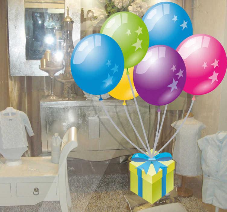 TenStickers. Sticker vitrine ballons cadeau. Sticker représentant un cadeau porté par des ballons multicolores. Adhésif applicable aussi bien dans un salon ou sur une vitrine de boutique.