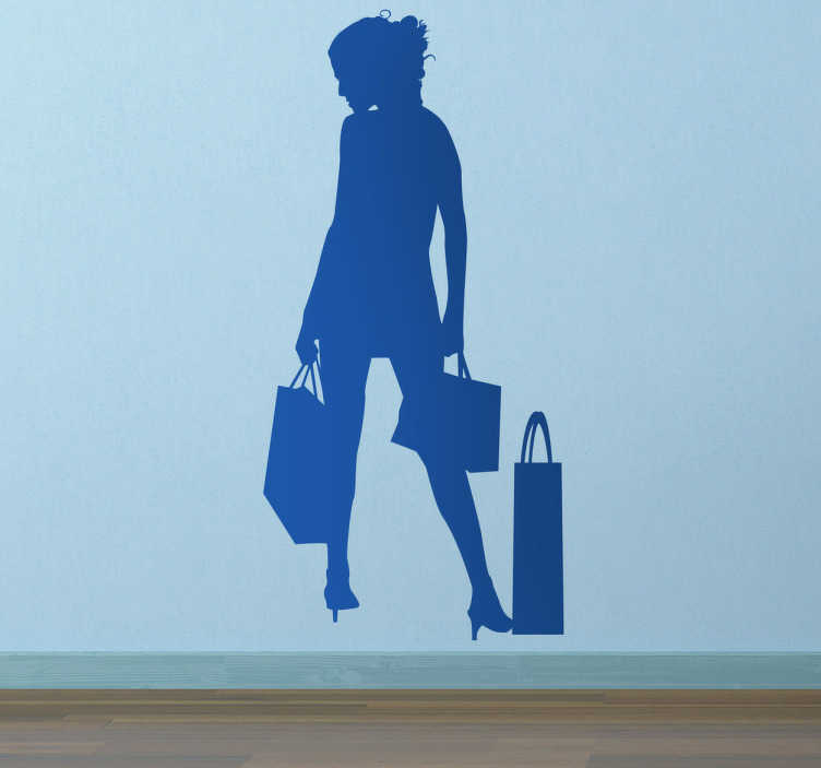 TenStickers. kvinde shopping sticker. business klistermærker - illustration af en ung kvinde med hendes indkøbsposer. Ideer til dekoration detail butikker. Fås i mange størrelser og farver