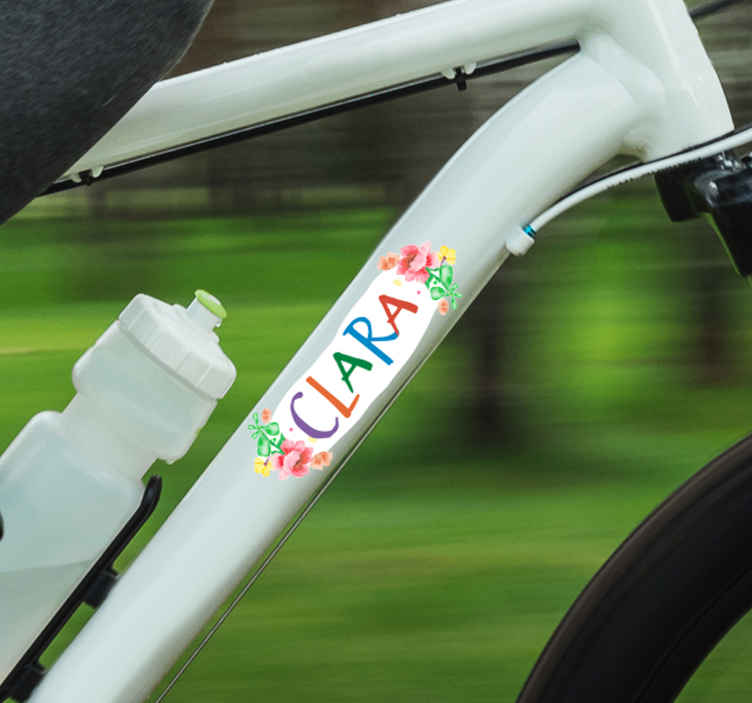 TenStickers. Flowers name Bike Decal. Personalisable name decorative bike frame decal with a flower design. Provide a desired name for the design to enjoy a beautify bicycle surface.
