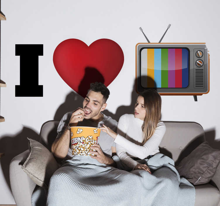 """TenVinilo. Vinilo original pared I love tv. Pegatina para pared formada por el texto """"I LOVE TV"""" representado a partir de un corazón y una televisión antigua. Promociones Exclusivas vía e-mail."""