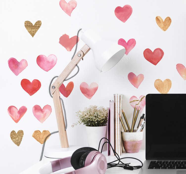 TenVinilo. Vinilo pared set de corazones. Original pack para habitación juvenil formado por 20 pegatinas en forma de corazón en tonos rosados y dorados. Vinilos Personalizados a medida.