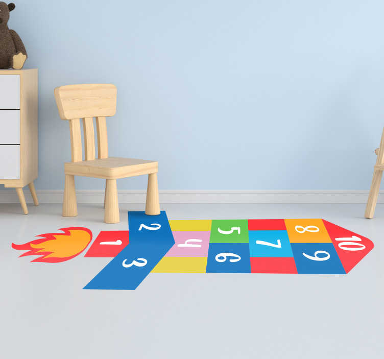 TenVinilo. Suelo vinílico rayuela cohete. Vinilo para el suelo de una habitación infantil formado por el juego de la rayuela con el diseño de un cohete. Vinilos Personalizados a medida.