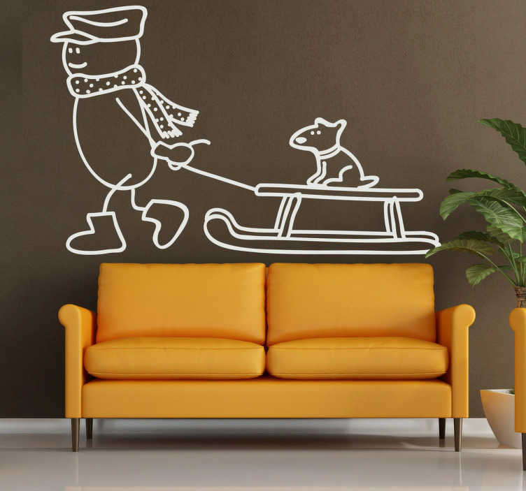 TenStickers. Sticker illustration chien traîneau. Stickers mural illustrant un bonhomme de neige tirant un petit chien sur traîneau.Autocollant applicable aussi bien dans un salon ou sur une vitrine de magasin durant la période de Noël.