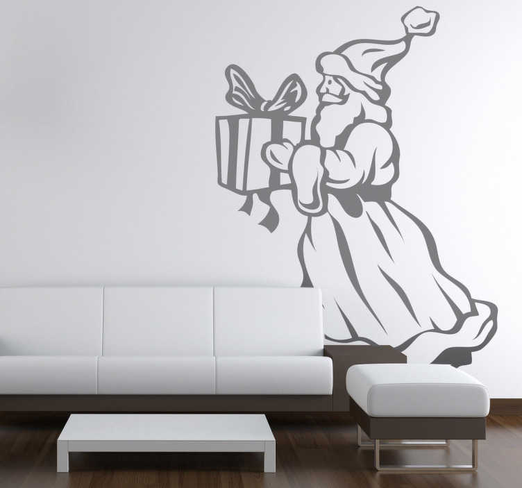 TenStickers. Santa Claus Holding Present Sticker. A decorative Christmas wall decal to give your home the look it needs during this season. Fantastic sticker to decorate your home.