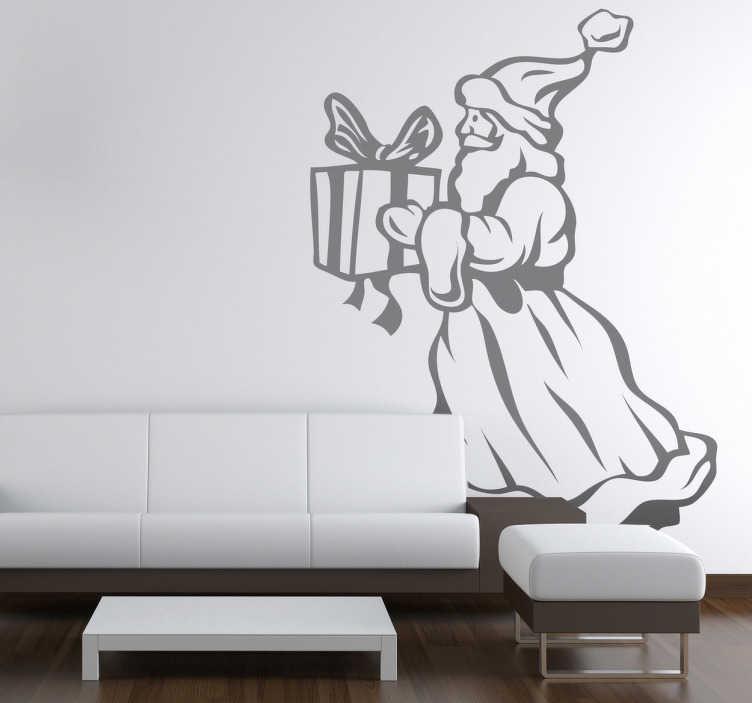 TenStickers. Naklejka świateczna Mikołaj z prezentem. Naklejka dekoracyjna przedstawiająca postać Świętego Mikołaja ubranego w tradycyjny kostium z pięknie zapakowanym prezentem.