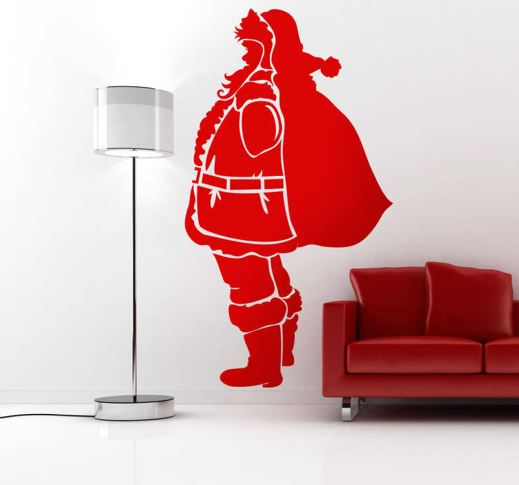 TenStickers. Kerstman sillhoutte sticker. Op deze muursticker zie je het silhouet van de kerstman van de zijkant met zijn grote zak vast! Kom helemaal in de kerstsfeer met deze wanddecoratie!