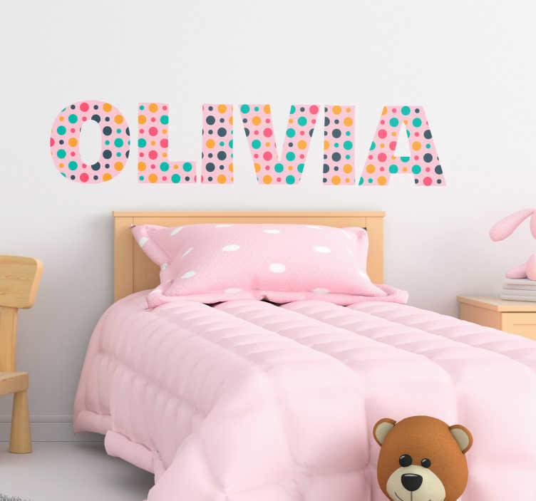 TenVinilo. Vinilo frase nombre hecho de puntos. Pegatina personalizable formada por el nombre de tu pequeña con un fondo rosa y decorada con unos puntos de colores. Vinilos Personalizados a medida.