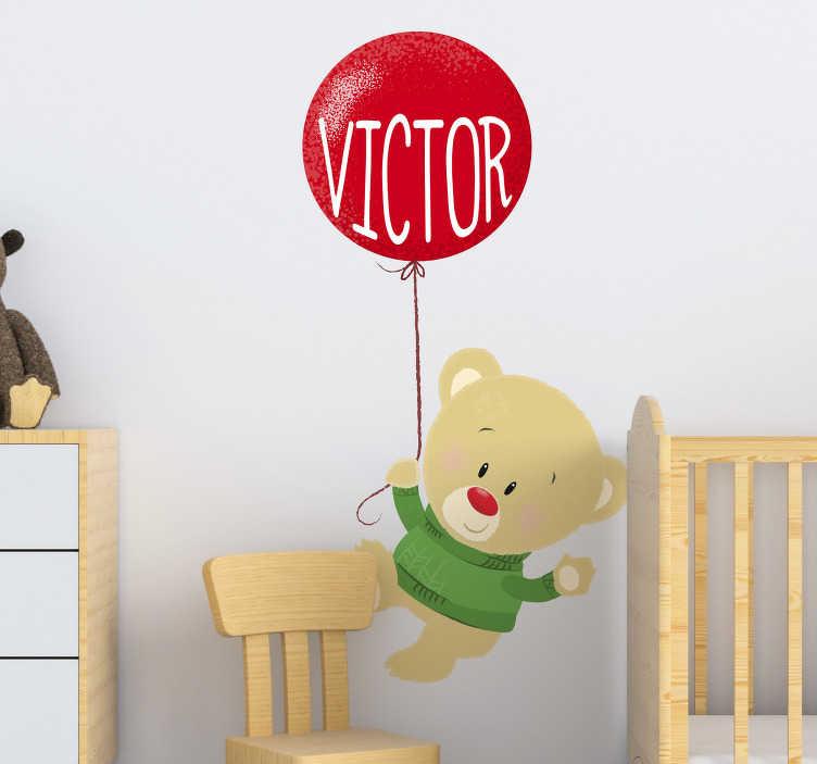 TenStickers. Sticker Mural Ours en peluche et ballon. Ce sticker personnalisé pour enfant représente un ours en peluche qui s'envole dans les airs à l'aide d'un petit ballon de bauderuche.