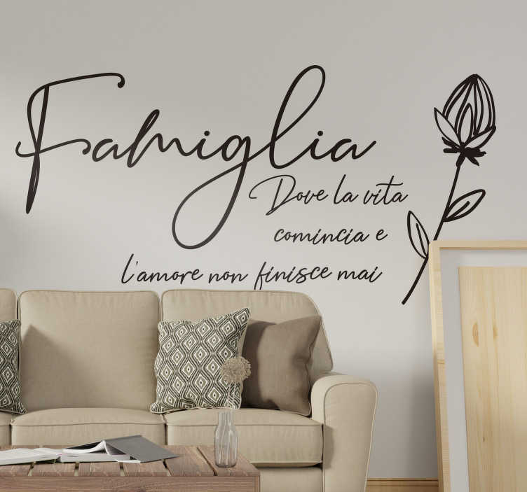 """TenStickers. Disegno per pareti frase famiglia. Se ami la tua famiglia, applica questa scritta adesiva con la frase """"Famiglia, dove la vita inizia e l'amore non finisce mai"""" e l'immagine di un fiore"""