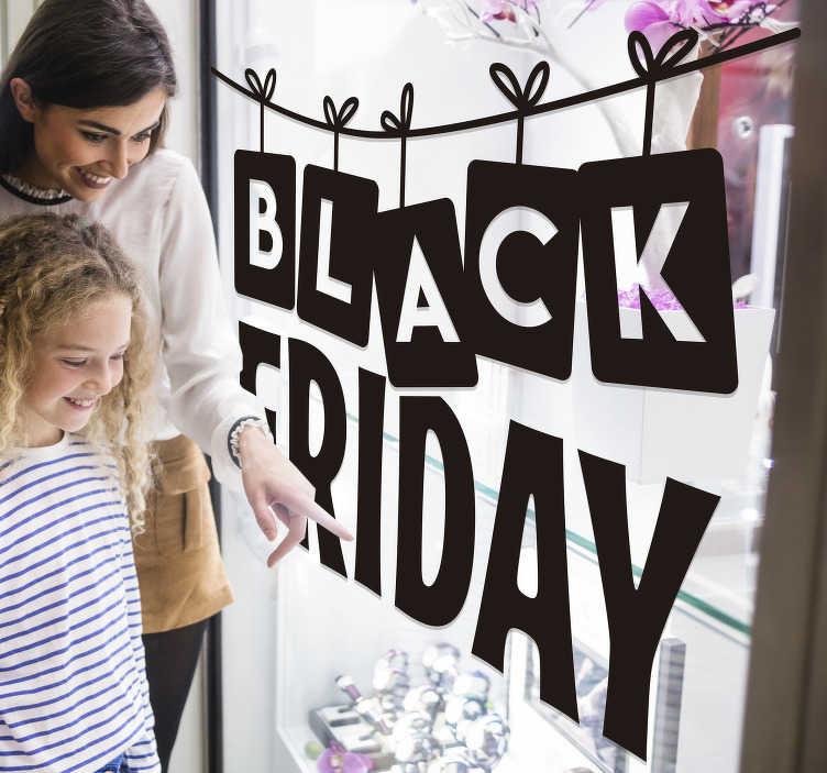 TenStickers. Raamstickers black friday aan een slinger. Black friday sticker aan touw voor de perfecte decoratie voor uw raam. Dit ontwerp bestaat uit de tekst ´black friday´ dat aan een slinger hangt.