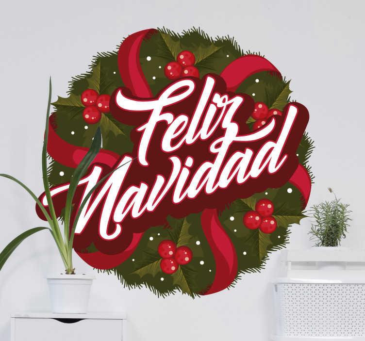"""TenVinilo. Pegatina navideña corona Feliz Navidad. Pegatina formada por el diseño de una corona, con cintas rojas a su alrededor y el texto """"Feliz Navidad"""". Descuentos para nuevos usuarios."""