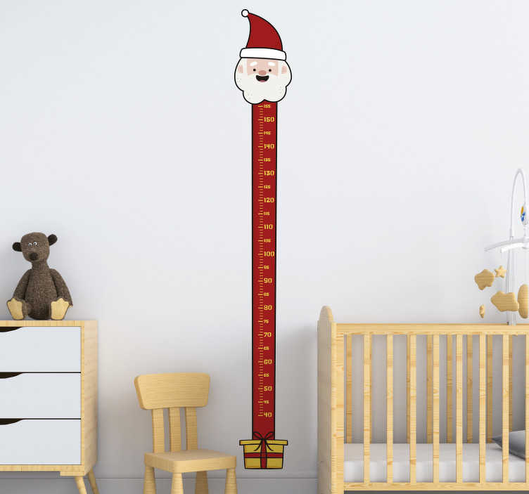 TenStickers. Santa Claus meter christmas wall decal. Easy to apply home Christmas wall decal created with a height chat with the face of Santa at the top and gift present at it base in red and yellow.
