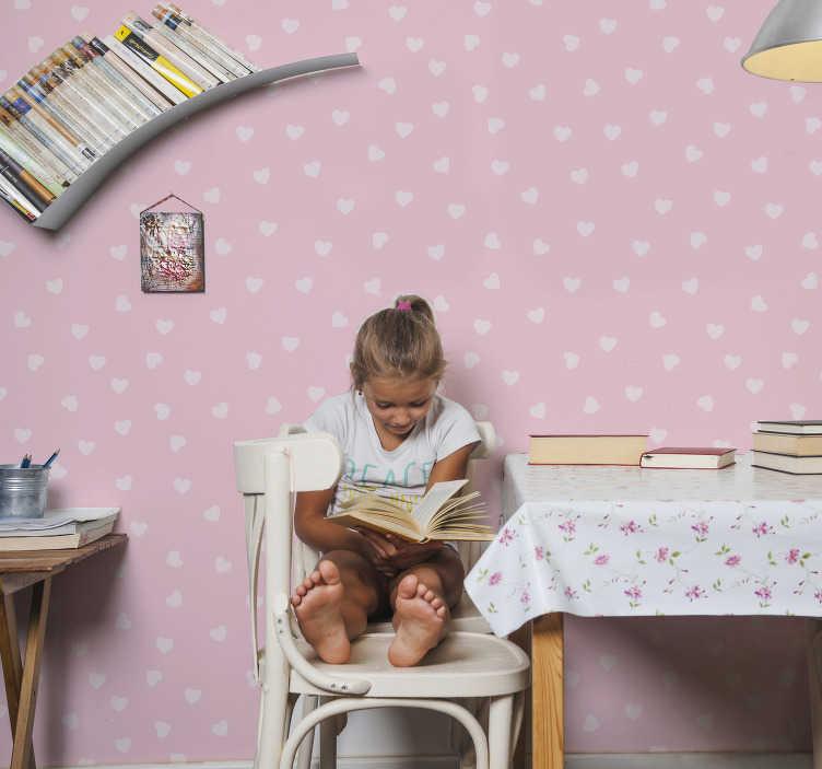 TenVinilo. Mural adhesivo infantil corazones. Adorable fotomural y mural adhesivo infantil con corazones blancos sobre fondo rosa con el que decorar la habitación de tu hija de forma especial.