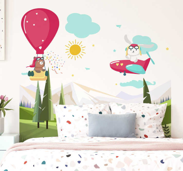 TenStickers. Mountains headboard illustration wall art. Easy to apply illustrative headboard wall decal with mountain and kids flying with air balloon and aeroplane around with the sun and cloud.