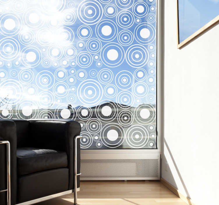 TenStickers. Naklejka na okno z rykoszetem. Zamów naszą naklejkę na okno, stworzoną z wielu okrągłych geometrycznych form. Możesz wybrać ją w dowolnym kolorze.