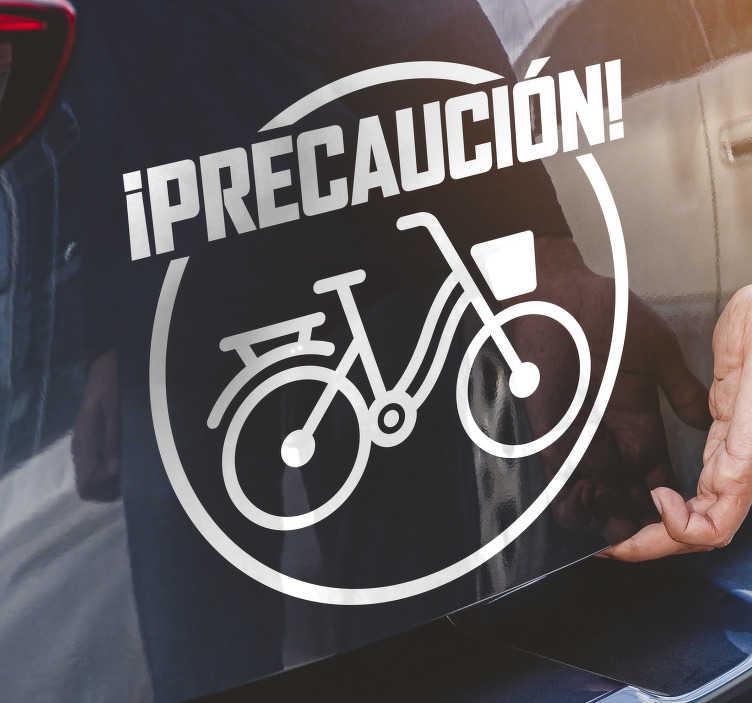 """TenVinilo. Vinilo automóvil precaución de ciclismo. Compre y aplique este vinilo de ventana de automóvil de ciclista creado con una bicicleta y un texto que dice """"precaución de ciclismo"""". Puedes tenerlo en cualquier color."""