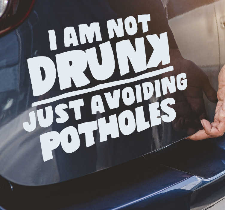 TenStickers. Not drunk, avoiding potholes car decal. A car window decal with the text '' am not drunk ,just avoiding potholes '' that you will love to apply on the surface of your vehicle. Easy to apply.