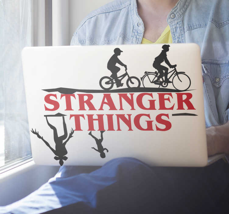 TenStickers. Stranger Things laptop laptop skin. Stranger Things series laptop skin sticker design. This design contains  two boy from the movie on their bicycle with the monster from upside .