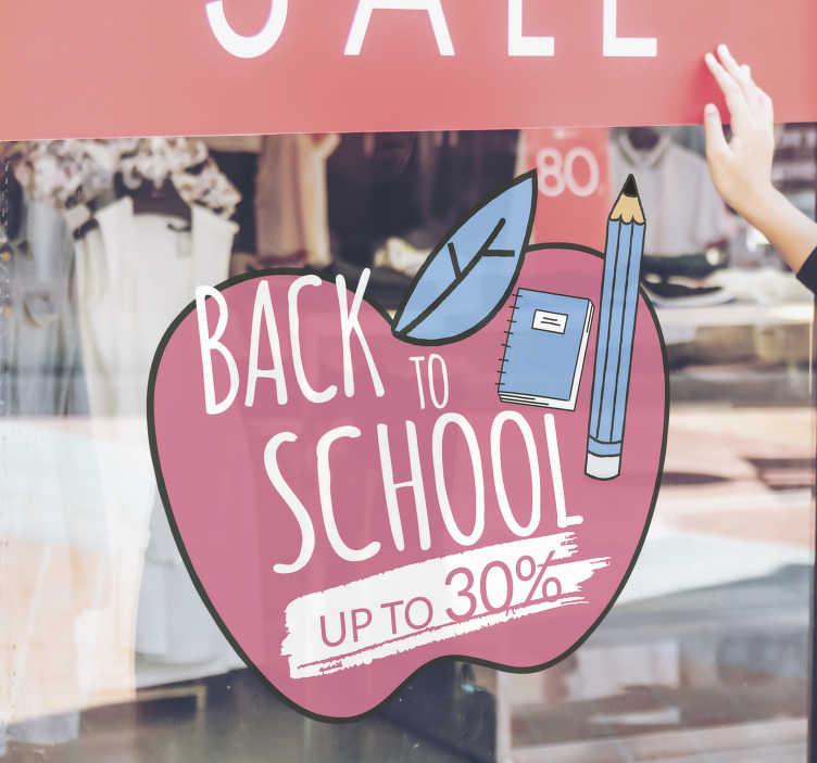 TenStickers. Back to school sale apple sale wall sticker. Back to school sale apple window sticker for shop designed of an apple in pink, bothered with black, on the apple has a book, pencil with sales text.
