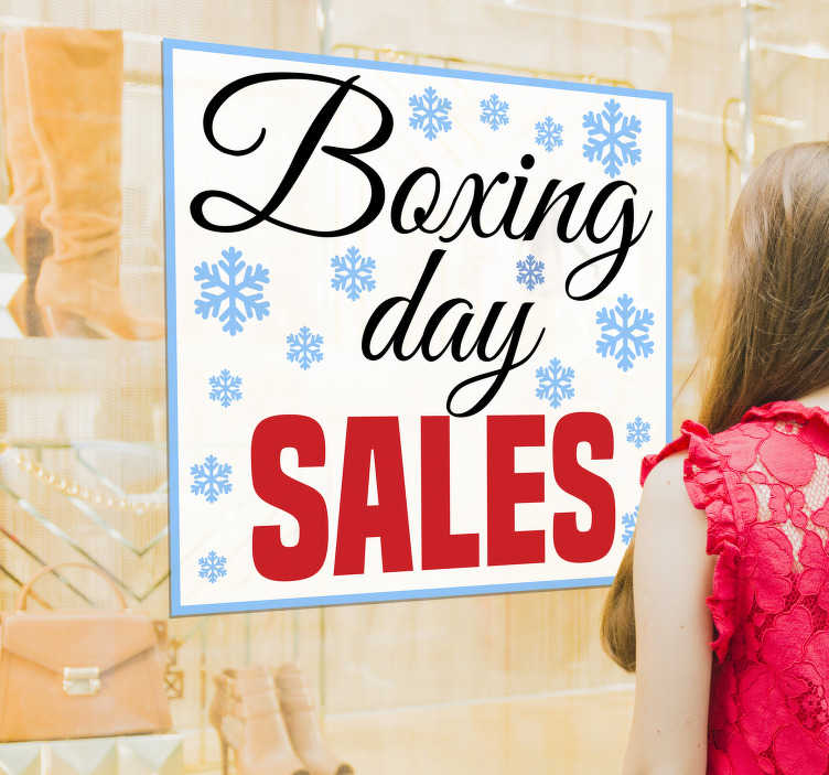 TenStickers. Boxing day snowflakes window decal. Shop window sales decal design in very nice colour of blue, red and white with little flowers and text to apply on your shop window to promote sales.