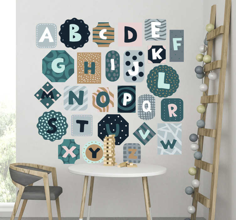 TenStickers. Alphabet nordic style alphabet wall decal. Easy to apply decorative alphabet bedroom wall sticker in different background shapes and colour to beautify the wall and a learning tool for kids.