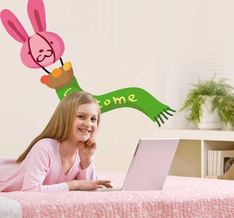 """TenStickers. Sticker kinderkamer konijn sjaal. Een leuke muursticker van een opblaasbare ballon in de vorm van een roze konijn met hier een groene sjaal met de tekst """" Welcome """"."""