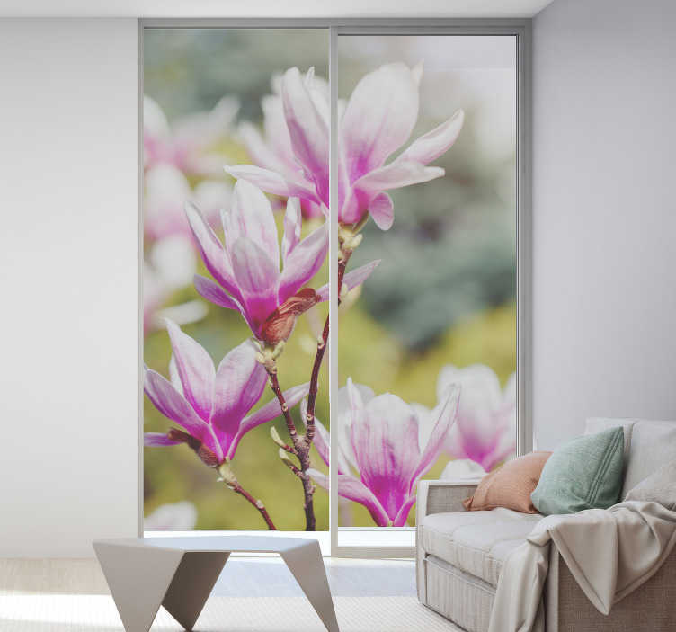 TenStickers. Magnolia flowers decoration window decal. Decorative window sticker for living room designed with a magnolia flower with a translucent background appearance to add glam to the home.