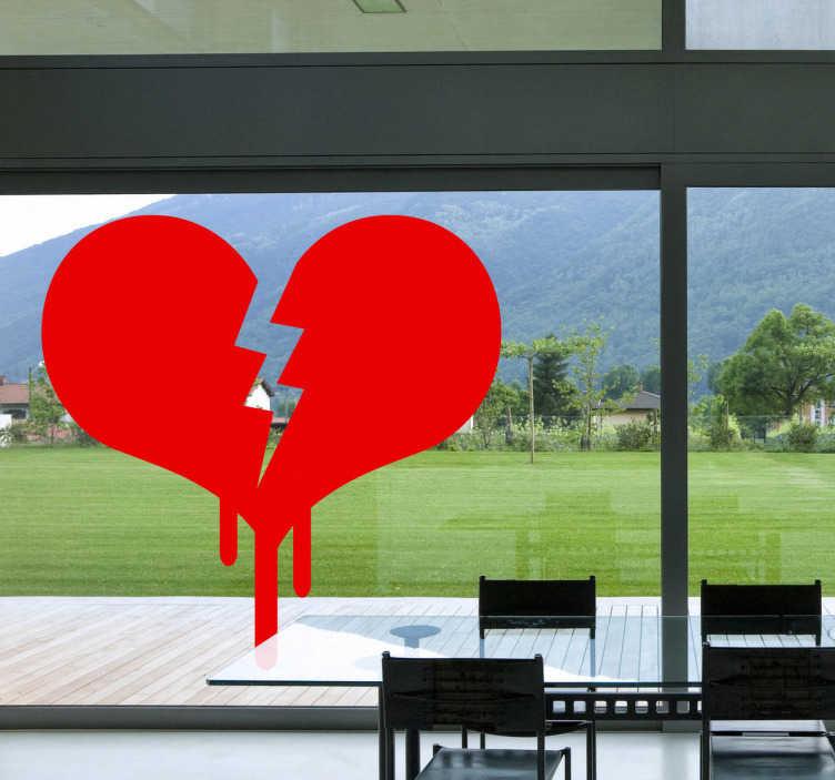 TenStickers. Naklejka na szybę złamane serce. Naklejka dekoracyjna, która przedstawia czerwone złamane serce. Ładna naklejka na powierzchnie szklane.