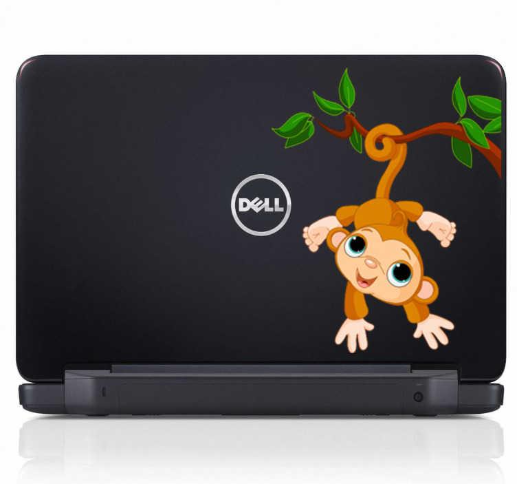 TenVinilo. Pegatina mono colita fuerte portátil. Vinilo para ordenador portátil de un simpático y sonriente simio colgado de la rama de un árbol mientras se coge fuerte con su cola.