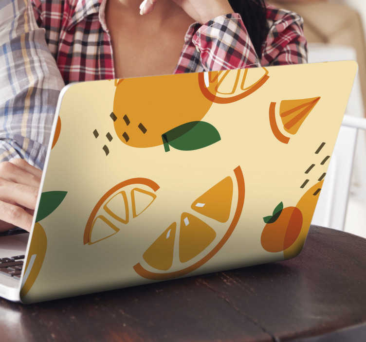 TenStickers. Oranges with memphis  laptop skin. Decorative laptop vinyl sticker with the design of an orange in Memphis style. Choose the dimension that fit the size of the laptop you have.