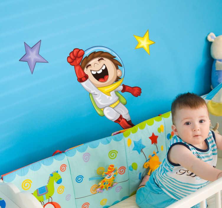 TenStickers. Naklejka dla dzieci wesoły astronauta. Kolorowa naklejka na ścianę przedstawiająca chłopca w stroju astronauty oraz dwie gwiazdy.