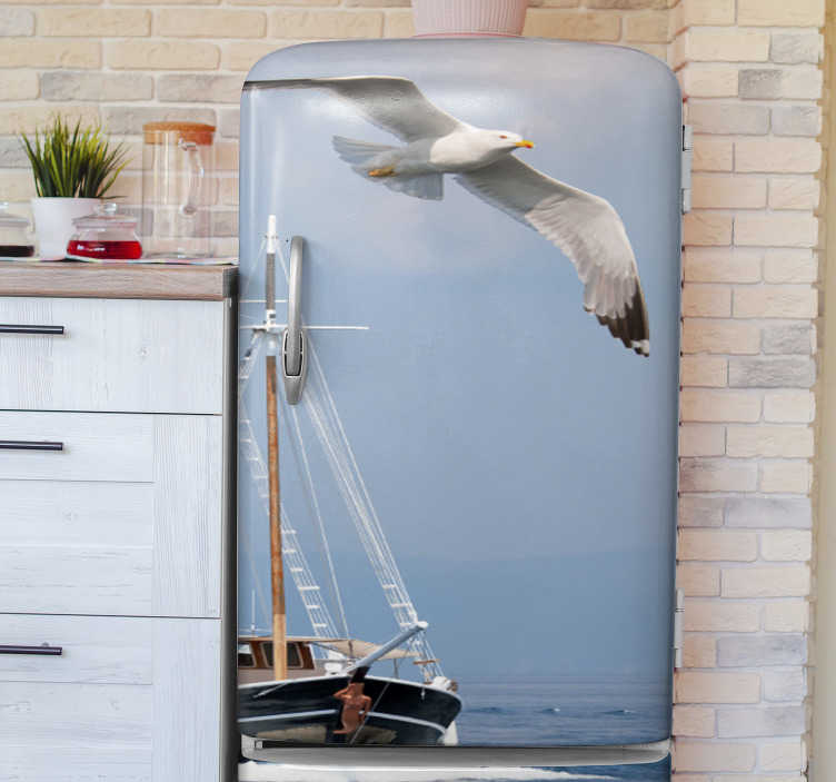 TenStickers. Polish seagull fridge wrap. Fridge wrap vinyl sticker to decorate a fridge with the image of a seagull flying over a ship. It is available in any required dimension.