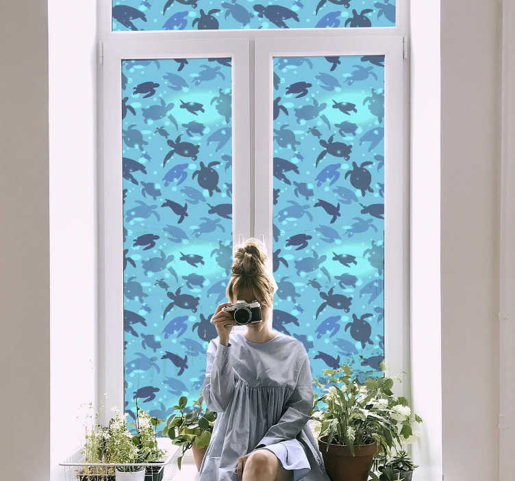 TenStickers. Turtles swimming window decal. Swimming turtles window sticker to decorate any window surface in the home. It is easy to apply and self adhesive. It is available in any size.