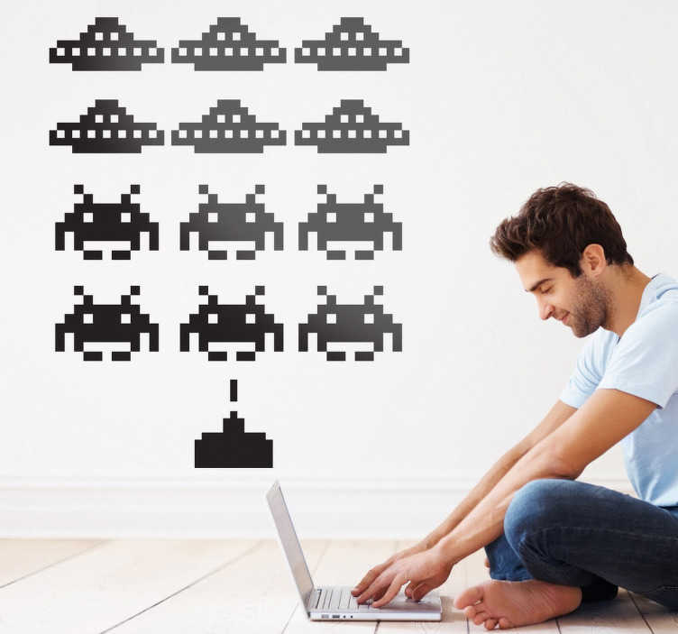 "TenStickers. Invaders Game Wall Sticker. Room Stickers - Inspired from the famous 80s game ""Space Invaders"". Designs ideal for decorating your home or business."