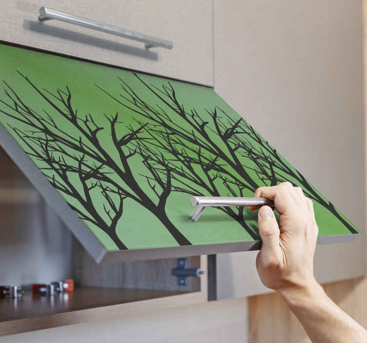 TENSTICKERS. 緑の背景の家具デカールのツリー. 緑の背景に設計された木が付いている装飾的な家具のステッカー。キャビネットやテーブルの表面に理想的な装飾。