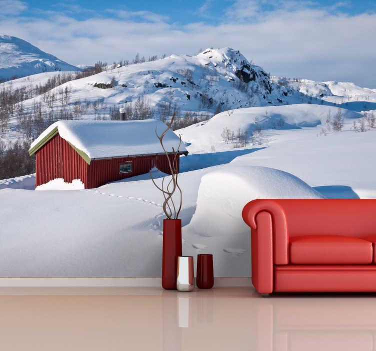 TenStickers. Sticker decorativo paesaggio neve. Fotomurale che ritrae un paesaggio coperto di neve al centro del quale sta un casolare rosso. Una decorazione ideale per gli amanti dell'inverno.