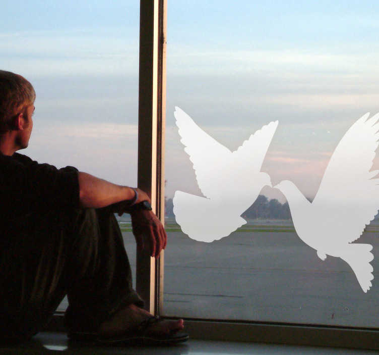 TenStickers. Silhoutte Doves Decal. Decals - Silhouette illustration of a couple of doves. An ideal feature for your windows. Available in various colours and sizes.