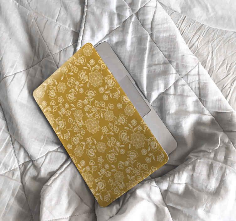 TENSTICKERS. 花の群れペイズリーラップトップスキンデカール. 新しい外観でノートパソコンを明るくする装飾的なラップトップステッカーデザイン。デザインは、黄色の背景にペイズリーのプリントで作成されています。