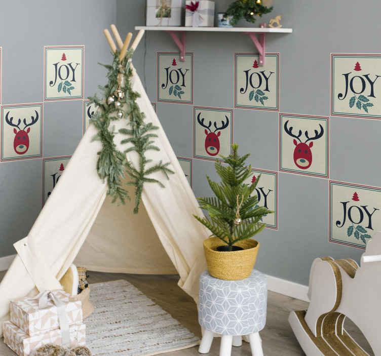 TenStickers. Stickers tegels Vreugde en rendieren. Decoratieve rendier en Joy tegelsticker gemaakt met verschillende kenmerken zoals rendieren, sierbloemen en de inscriptie met de tekst '' joy.