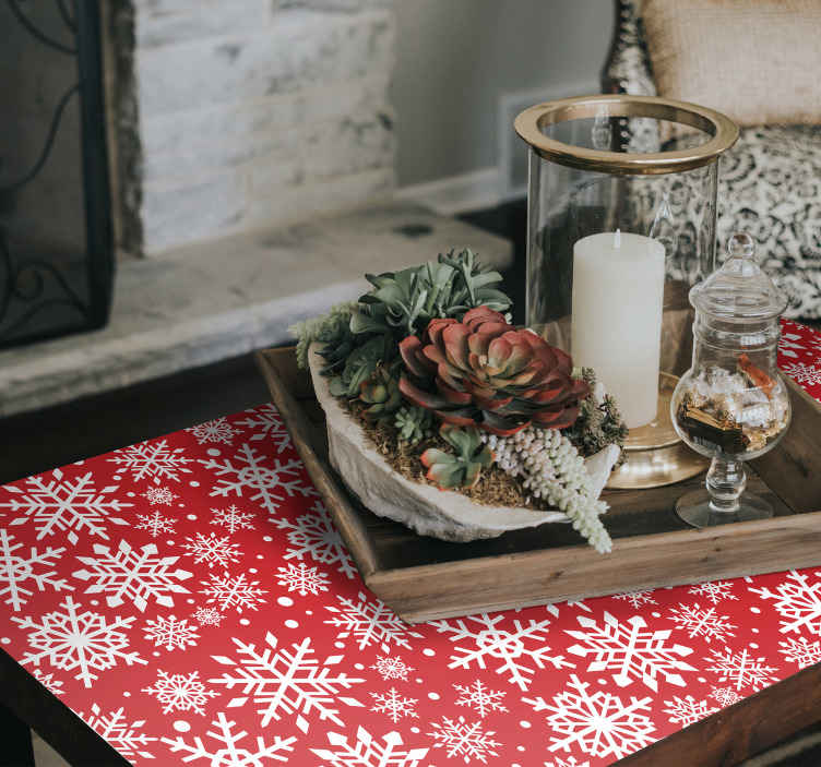TenStickers. Stickers voor op meubels Rode sneeuwvlokken. Een sneeuwvlokken meubelsticker voor tafel, lade etc. Is gemakkelijk aan te brengen en gemaakt van hoogwaardig vinyl. Verkrijgbaar in elke gewenste maat.