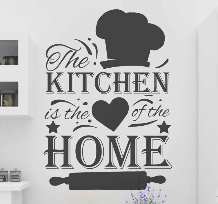 """TenVinilo. Frase para la pared cocina corazón de la casa. Vinilo pared cocina de frase con la cita """"la cocina es el corazón de la casa"""" con gorro de cocinero y corazón ¡Envío a domicilio!"""