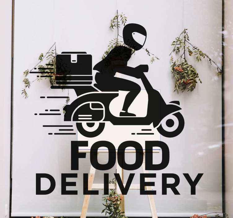 """TenVinilo. Vinilo para escaparates entrega de comida con moto. Vinilo para escaparates tienda con frase inscrita que cita """"food delivery"""". El diseño es un repartidor en moto ¡Envío a domicilio!"""