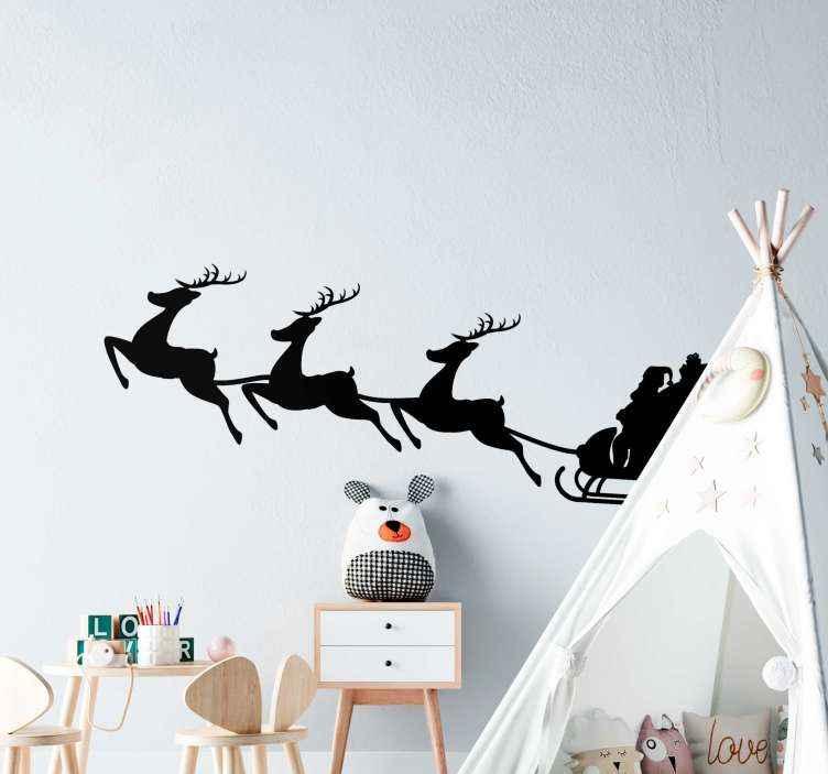 TENSTICKERS. そりのサンタクロースクリスマスウォールステッカー. そりに乗ったサンタクロースが飾られた装飾的なクリスマスウォールステッカー。さまざまな色とサイズのオプションで利用できます。