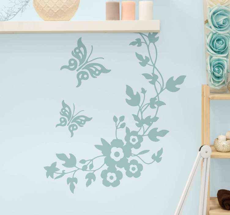 TENSTICKERS. 渦巻き模様の枝を持つ花蝶の花の壁の装飾. さまざまな色のオプションでカスタマイズ可能な装飾用の花のウォールステッカーのデザイン。花のデザインは蝶と渦巻くスタイルで作られています。