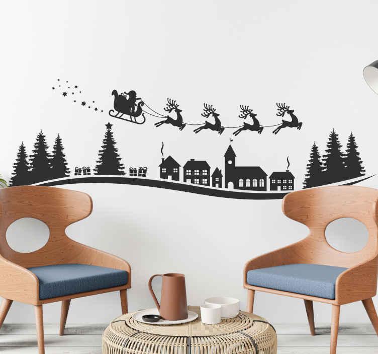 TenStickers. Kerststickers Santa vliegen met sterren en sneeuwvlokken. Decoratieve kerst decoratie voor kinderen met kerstman en slee. Het ontwerp kenmerkt de kerstman op een kar getrokken door rendieren.