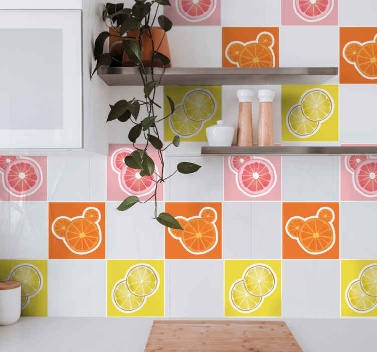 TenVinilo. Azulejos vinílicos coloridos rodajas frutas. Estos vinilos cocina azulejos de colores brillantes presentan limones, naranjas y pomelos en rodajas en fondos coloridos ¡Decora tu cocina!