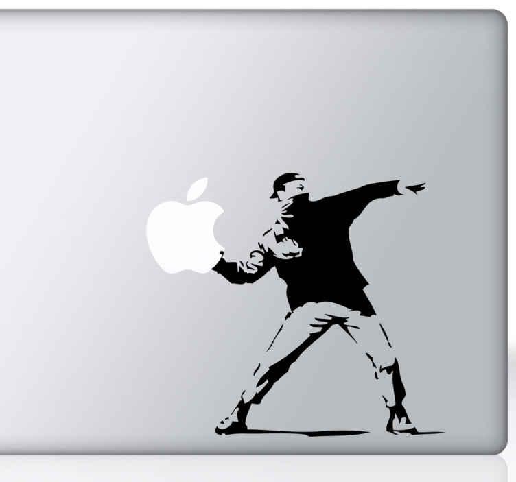 TenStickers. 银河革命macbook贴纸. 一个设计说明了banksy的艺术,花朵取代了你的macbook的苹果标志。我们的macbook贴纸系列的设计。
