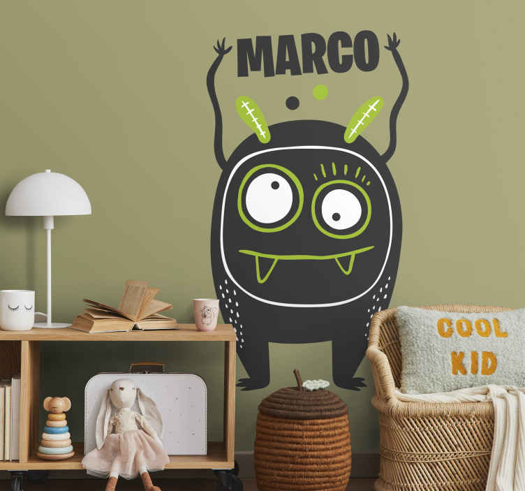 TenStickers. Kids Multiple Eyes Alien Wall Sticker. Kids Wall Stickers - Playful illustration of a square shaped alien with many eyes and funny teeth. Available in various sizes and 50 colours.